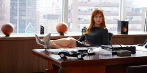 Donna at Harvey's desk