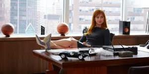 Donna at Harvey's desk