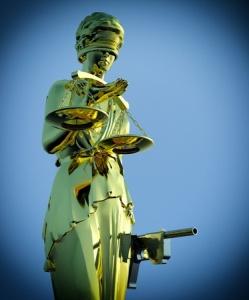 Justice has a gun